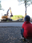 K watching the diggers at work.
